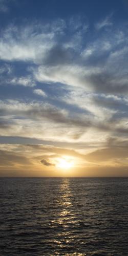 Ondergaande zon & zee
